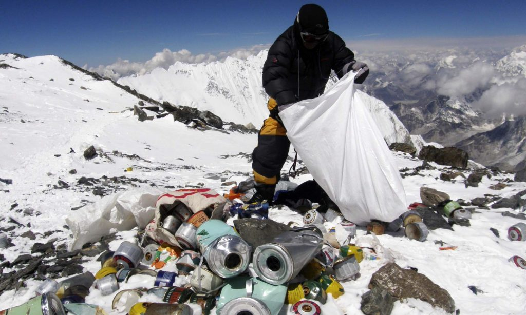 (FILES) This picture taken on May 23, 2010 shows a Nepalese sherpa collecting garbage, left by climbers, at an altitude of 8,000 metres during the Everest clean-up expedition at Mount Everest.  Climbers scaling Mount Everest will have to bring back eight kilograms (17.6 pounds) of garbage under new rules designed to clean up the world's highest peak, a Nepalese official said March 3, 2014.     AFP PHOTO/Namgyal SHERPA/FILESNAMGYAL SHERPA/AFP/Getty Images